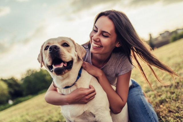 loving pet owner with her adopted dog
